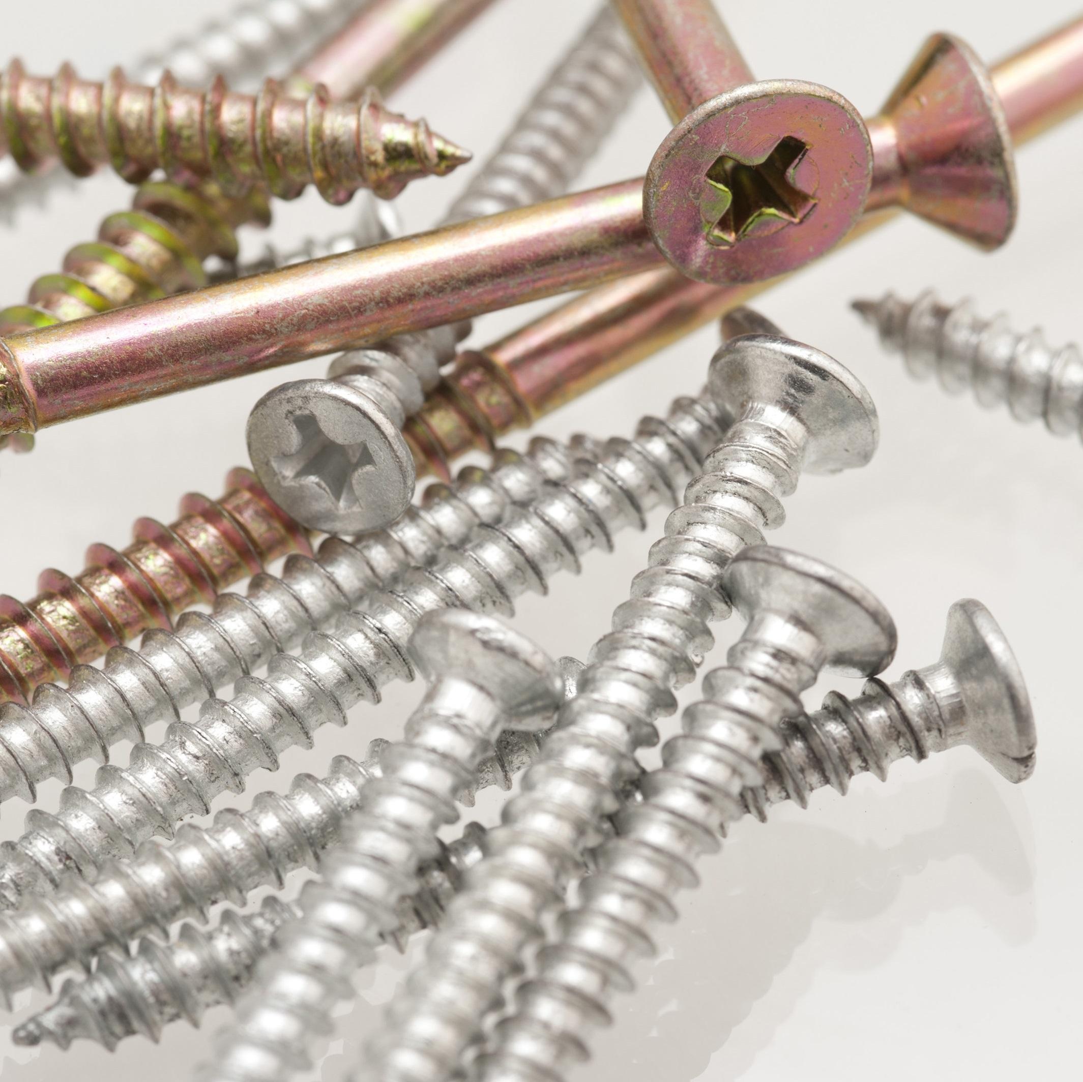 Variety of screws in a haphazard pile